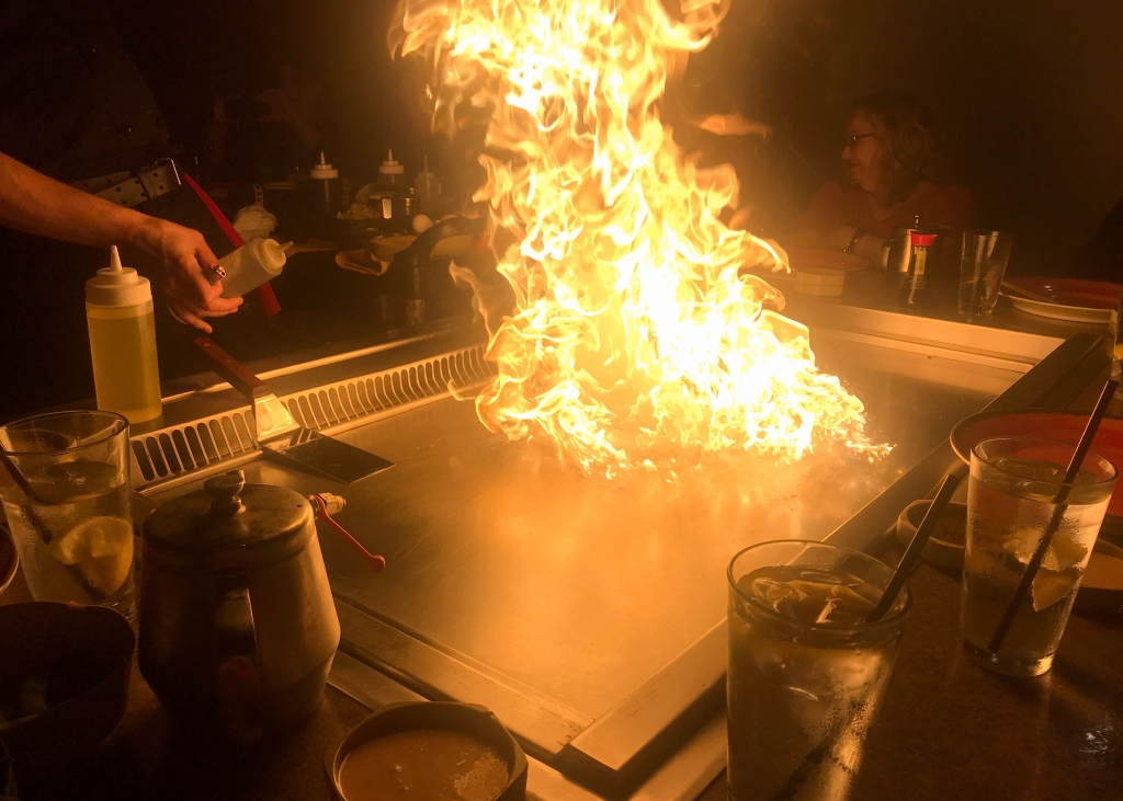 Hibachi grill with rising flames.