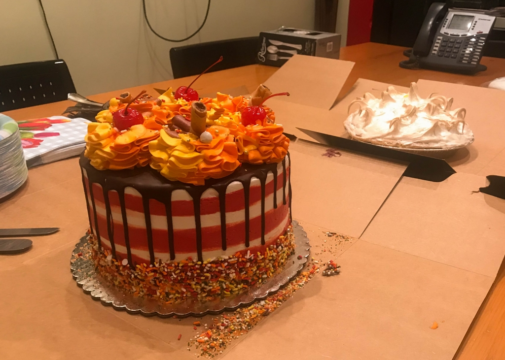Colorful cake and dedicate pie to celebrate National Boss's Day.